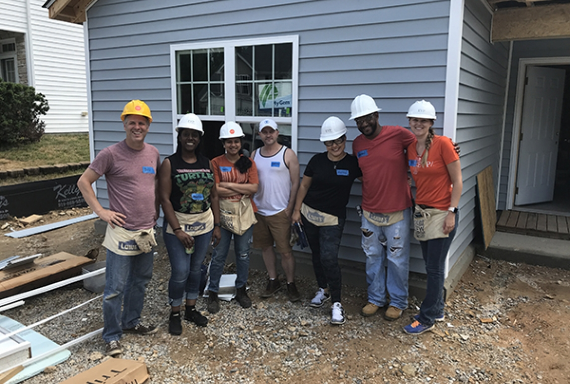 A group of EYP employees working on a Habitat for Humanity house