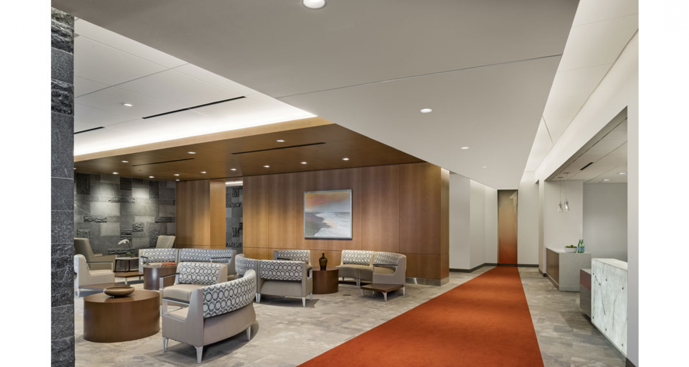 The surgery department's family waiting room features seating configurations using the emblem and form created during the design of the hospital. The waiting room also includes a nourishment bar.