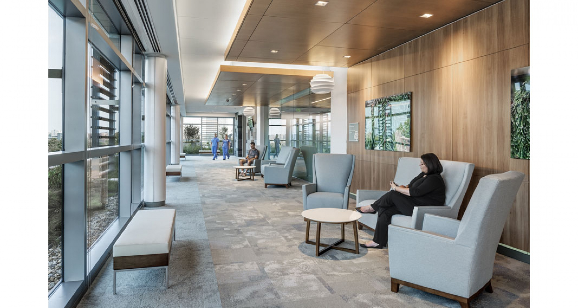 Use of natural light and warm colors gives families in the waiting area a place to relax while viewing the green roof.