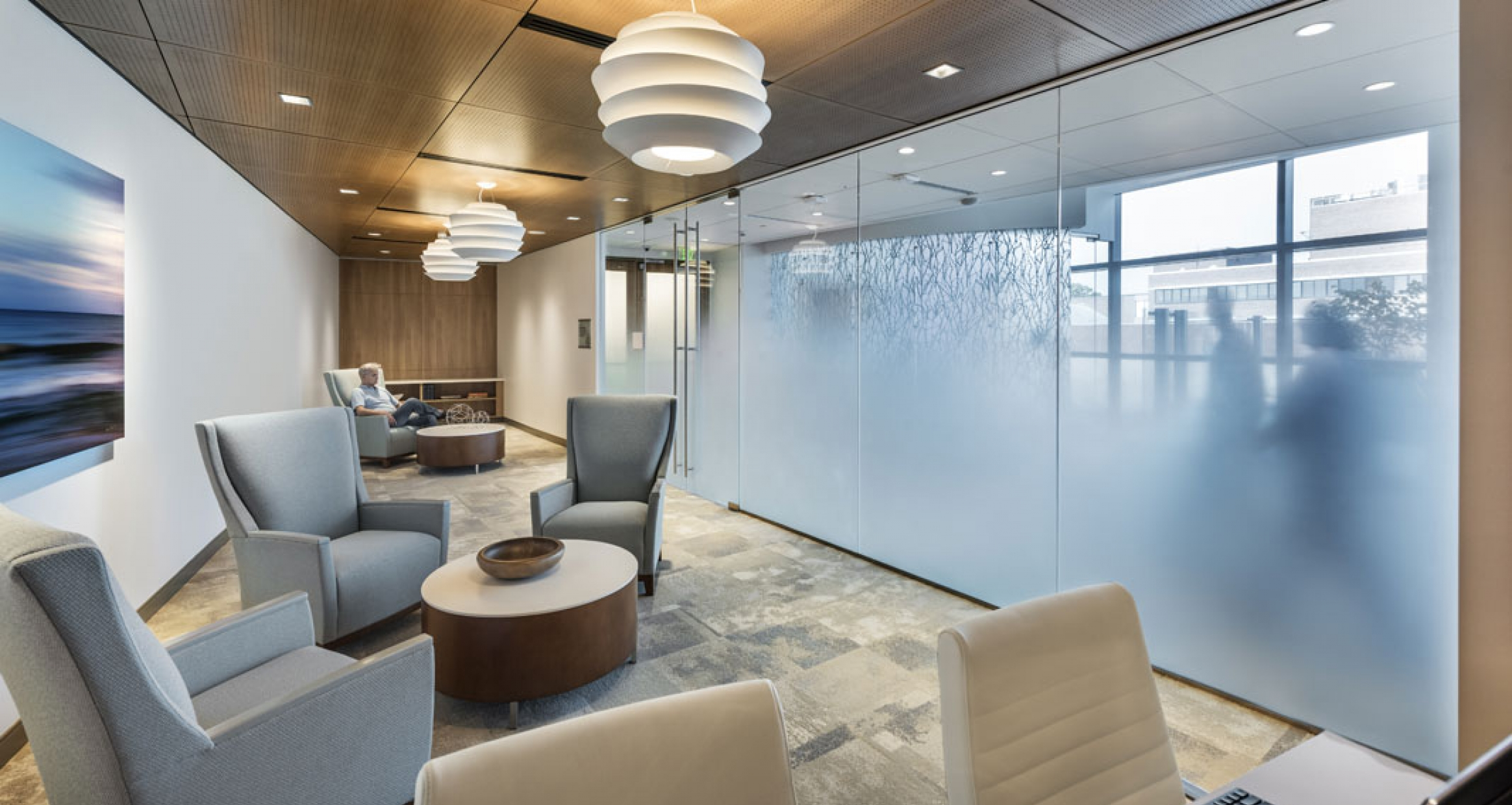 The ICU quiet waiting area features soft blues, natural light and frosted glass offering a private place to relax or utilize the resource center.
