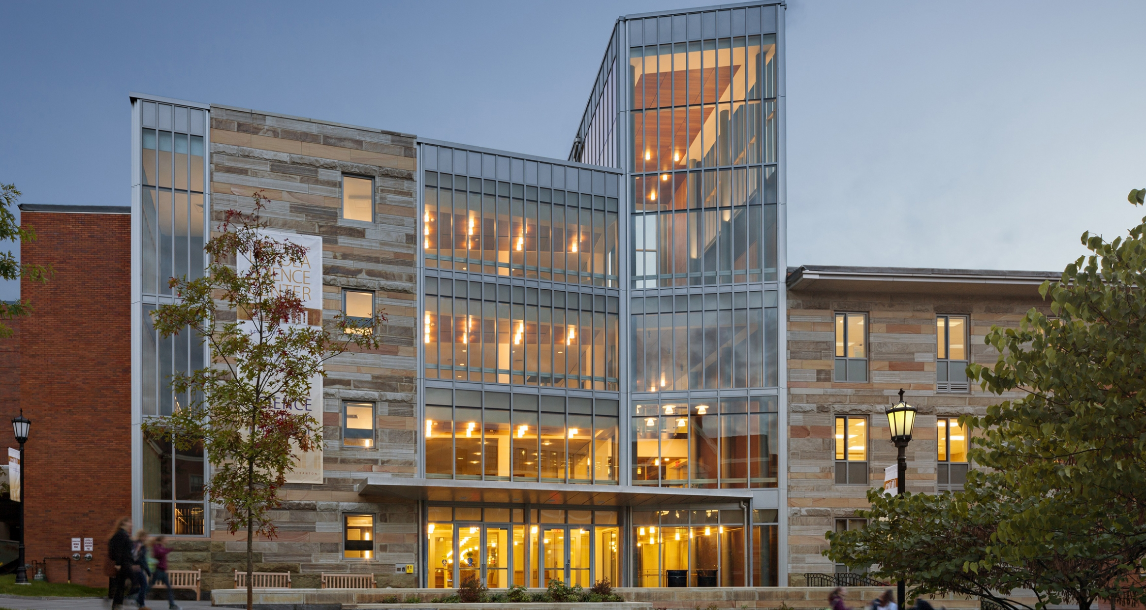Exterior facade of Loyola Science Center at dusk