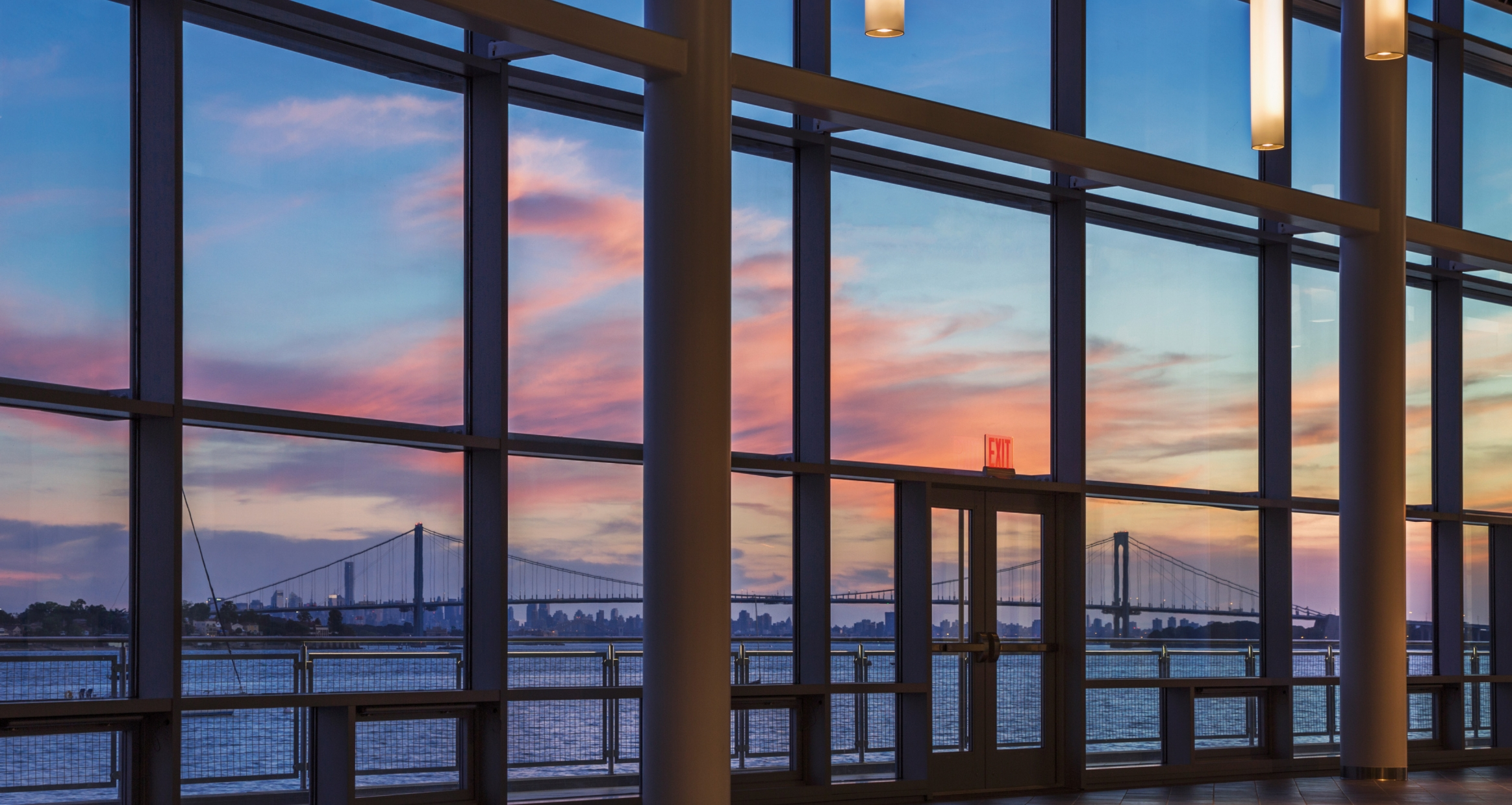 Expansive windows provide ample view of the harbor