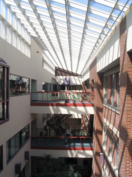 Existing atrium and masonry wall