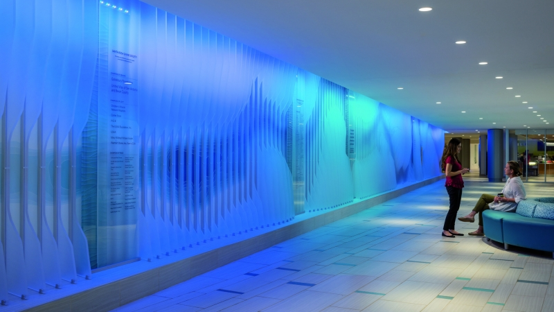 The illuminated wall represents the San Antonio River, as well as the calming therapeutic aspects of water at The Children's Hospital of San Antonio.