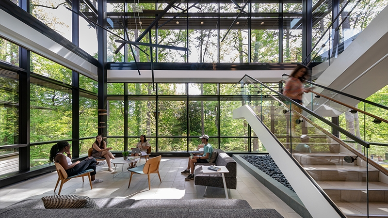 interior shot of wellness center lobby with students interacting in the space